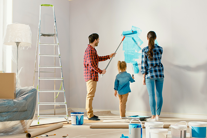 Family painting their home and doing a dyi project.
