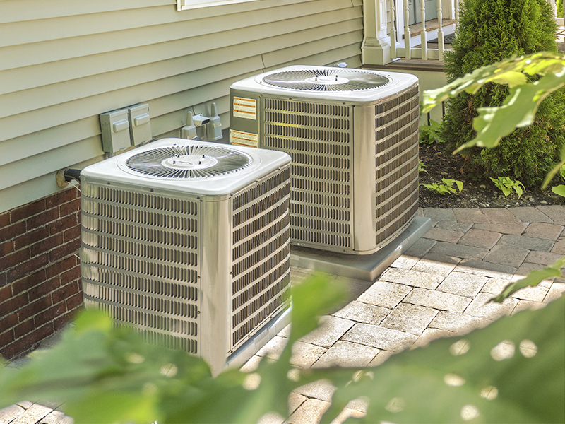 HVAC furnace units located on the perimeter of the home.