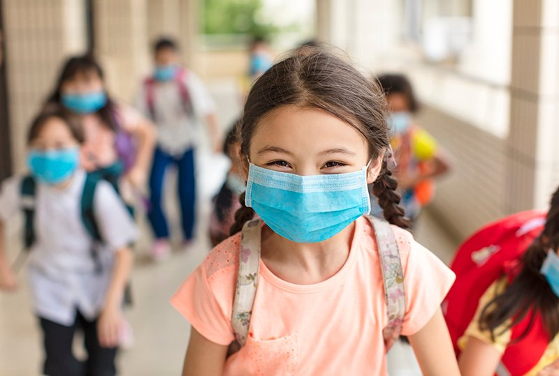 Girl wearing a mask going back to school